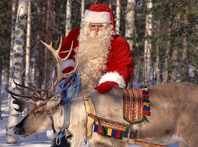 Santa Claus with one of his reindeer.'