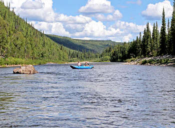 Boating and fishing up river in Alaska.> </p> <!---HIDE-ME--->  <div class=